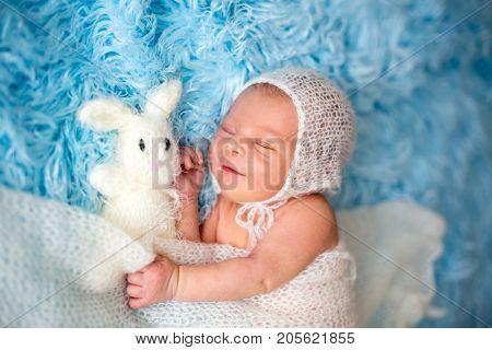 Little Cute Newborn Baby Boy, Sleeping Wrapped In White Wrap