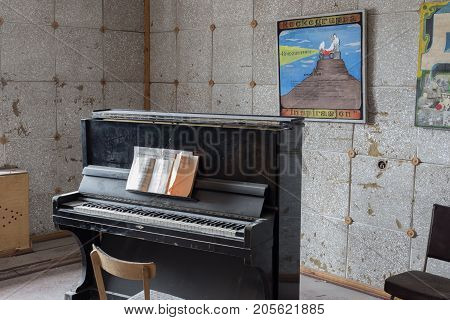 Pyramiden Norway - August 2017: Interior of a music room in cultural and sport center in the abandoned Soviet/ Russian settlement Pyramiden in Svalbard archipelago. Probably the northermost piano in the world.