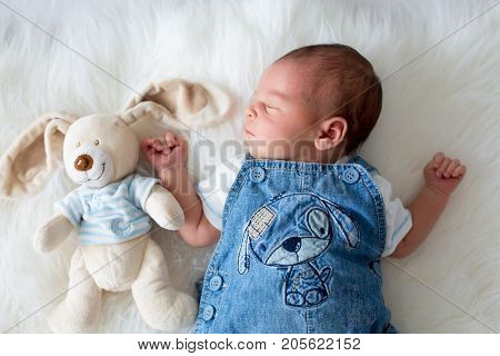 Fashionable Little Newborn Baby Boy, Sleeping In The Afternoon At Home In Bed