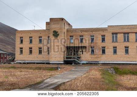 Pyramiden Norway - August 2017: Hospital in the abandoned Soviet/ Russian settlement Pyramiden in Svalbard archipelago. The hospital is closed and not accesible for tourists because many drugs and medicines can still be found inside.
