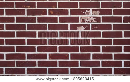 Red brick wall background style decor grunge peeling paint and moldy.