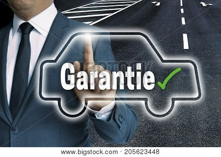 Garantie (in German Warranty) With Car Touchscreen Is Operated By Man