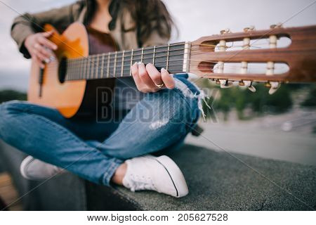Acoustic guitar song. Live music on nature. Freedom, leisure, guitarist concert, unrecognizable young bard and composer concept