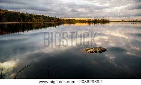 Autumn landscape.Lake at sunset in autumn forest
