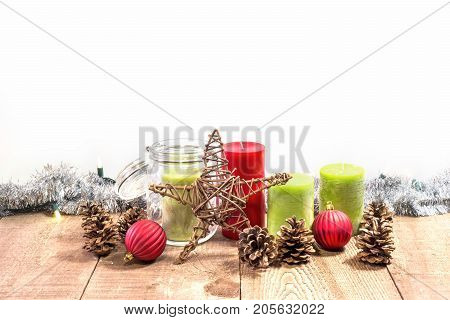 Candles, Jar, Wooden Star And Pinecones On Rustic Wooden Table With Christmas Lights And Tinsel