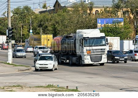 A Truck With A Tank For Transportation Of Petroleum Products Stands At The Traffic Lights With Publi