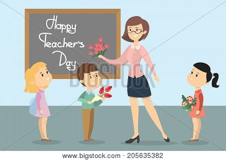 Happy teachers day. Smiling students and teacher with flowers.