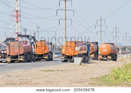 Trucks With Tanks For Transportation Of Petroleum Products And Containers Are On The Road In Front O