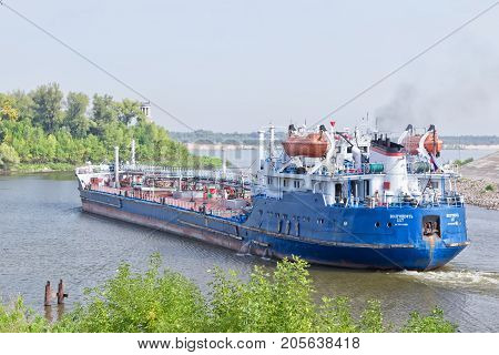 Barge For Transportation Of Various Petroleum Products Turns Out Of The Shipping Channel Into The Ch