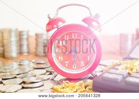 Stack Of Coins With Red Fashioned Alarm Clock For Display Planning Money Financial And Business Accounting Concept Time To Work At Make Money Concept Vintage Color Tone