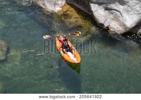April 17, 2015 La Ceiba, Honduras: Kayaker On The Canrejal River In The Pico Bonito National Park