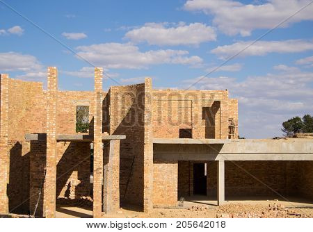 New house constrction site on a sunny day with blue sky and clouds
