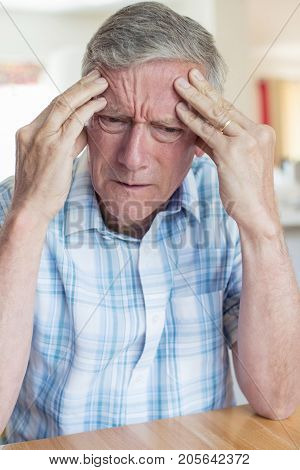 Mature Man At Home  Suffering From Memory Loss