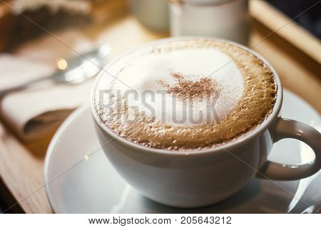 Soft focus on capuccino coffee cup coffee for background - vintage effect process picture