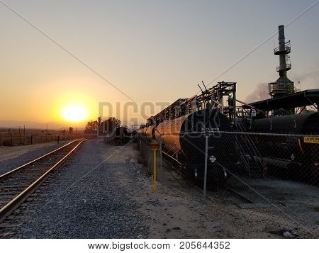 BAKERSFIELD, CA - AUGUST 20, 2017: Tank cars are on a siding awaiting product from a Central California oil refinery.