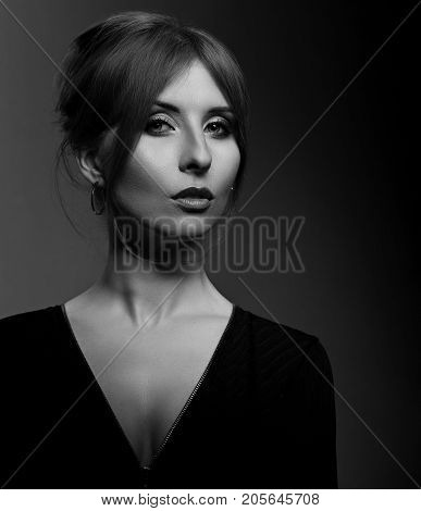 Beautiful Woman With Long Elegant Neck In Fashion Black Jacket Looking Mystic And Calm On Dark Shado