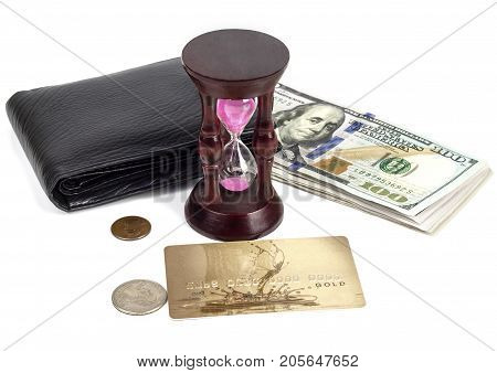 Dollars cents a plastic card a purse an hourglass on a white background