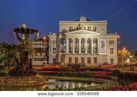 RIGA, LATVIA - september, 2017: Latvian national opera and ballet theater and fountain the Nymph in park. Riga, Latvia.