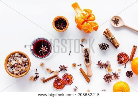 Ingredients of hot mulled wine or grog set with spices and citrus for winter evening. Christmas and new year eve. White background top view.