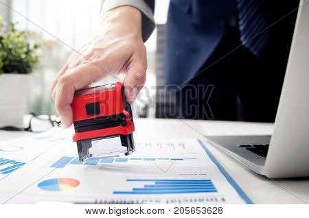 Businessman Analyst Working With Graph, Chart And Stamp