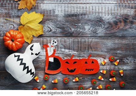 Halloween Candies With Pumpkin On Brown Wooden Table