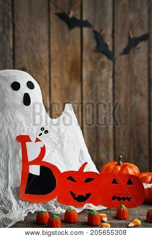 Halloween Candy Corns With Ghost On Wooden Table