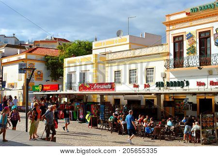 Albufeira Algarve Portugal - October 31 2015 : Tourists eating and drinking in restaurants in the old town of Albufeira Portugal