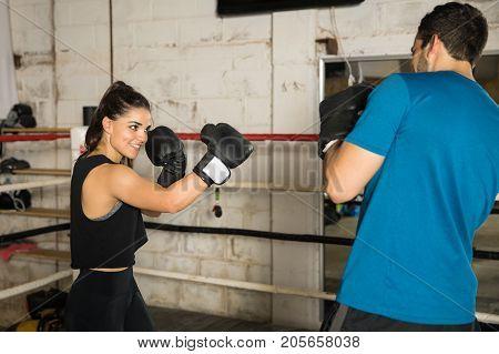 Female Boxer Teasing Her Opponent