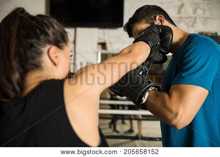 Man Getting Hit By A Female Boxer