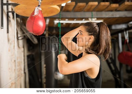 Woman Punching A Speed Bag