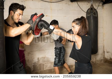Using Boxing Mitts During Boxing Class