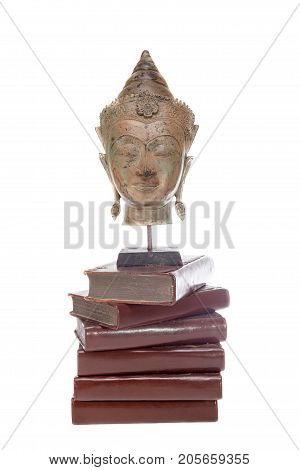 Philosophy ethics and religion. Statue of the philosopher Buddha on ancient teaching books isolated against white background. Philosophical teaching and wisdom.