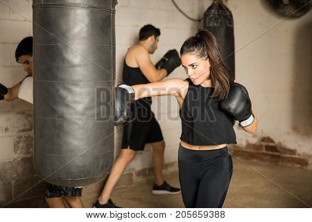 Woman Training In A Boxing Gym