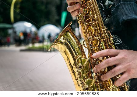 Hands of saxophone player close-up, selective focus, copy space