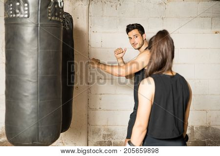 Male Boxer Giving Advice To A Woman