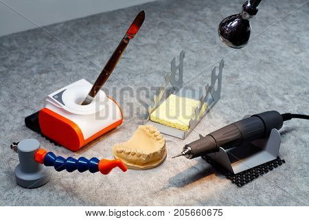 dentist orthopedist tools workplace of dental orthopedist scalpel milling cutter form tooth matrix denture laboratory