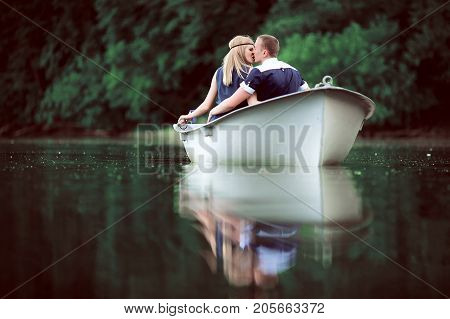 tender couple kissing on the white boat, cute pair enjoy vocation, man and woman happy together concept