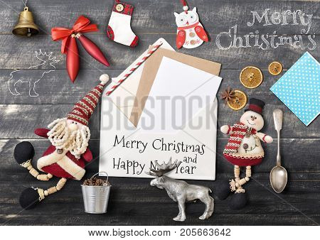Merry Christmas Greeting Card with Santa Claus and Xmas Elements on Black Wooden Background. Retro Style.