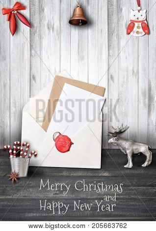 Merry Christmas Greeting Card with Elk and Xmas Elements on Black Wooden Background. Retro Style. Vertical Format.
