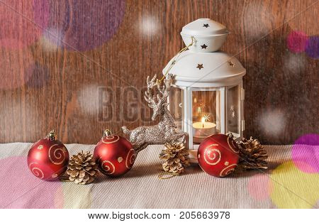 Christmas lantern and christmas decorations on wooden background