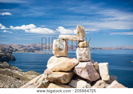 Stone Cairn With Scenic Dramatic Landscape On Island Of The Sun, Titicaca Lake, Among The Most Sceni