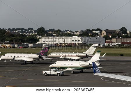 Boston USA 23.09.2017 - business jet airplane or aircraft with open door on airfield near of aeroport terminal