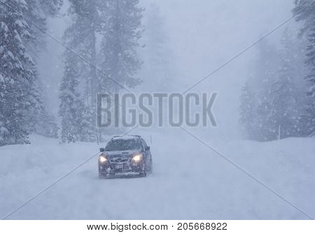 Landscape with snowfall and car on winter road.