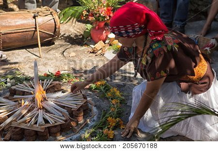 January 31, 2015 San Pedro La Laguna, Guatemala: Mayan Women Lighting Up Fire Started With Candles A