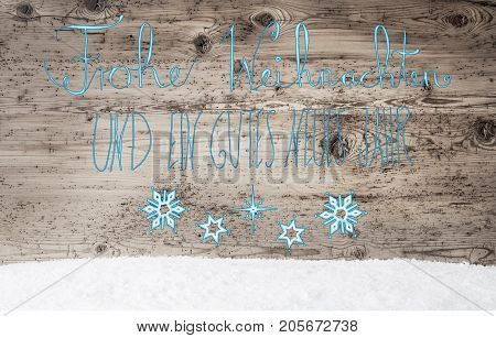 Turquoise German Calligraphy Frohe Weihnachten Und Ein Gutes Neues Jahr Means Merry Christmas And Happy New Year. Rustic Wooden Background With Snow