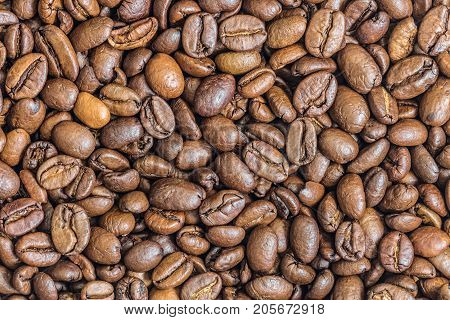 Roasted coffee beans texture close-up. Coffee background.