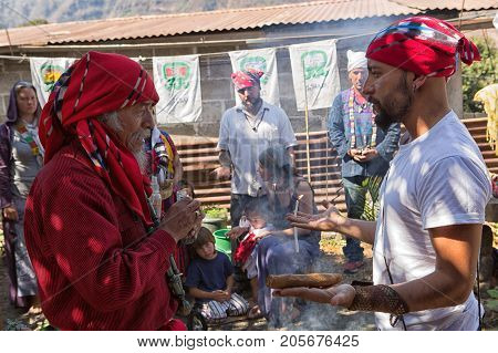 January 31 2015 San Pedro la Laguna Guatemala: tata Pedro Cruz one of the last authentic elderly Mayan shamans performing ritual with a younger man