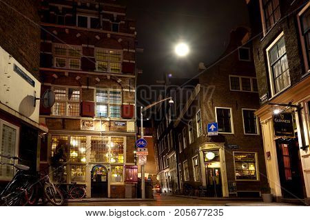 AMSTERDAM, NETHERLANDS - 12rd of MARCH 2012: Beautiful little traditional houses in Amsterdam by night background. March 12th, 2012. Amsterdam, Netherlands.
