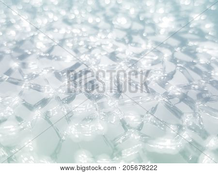 Abstract blurred and bokeh crystal soil whit color effect for texture background