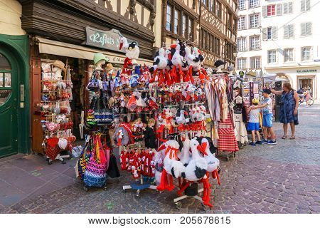 Strasbourg Alsace France - July 18 2017: Gift shop vintage style on street in Petite-France in Strasbourg Traditional colorful houses in La Petite France Strasbourg Alsace France